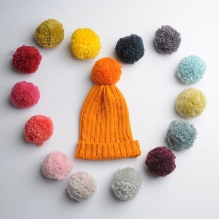 Mrs Moon Rib Hat in Marmalade colour with 15 pom pom colours